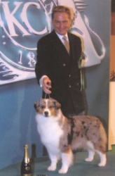 Pictured with her handler and co-